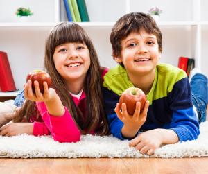 Kids eating healthy snacks inside